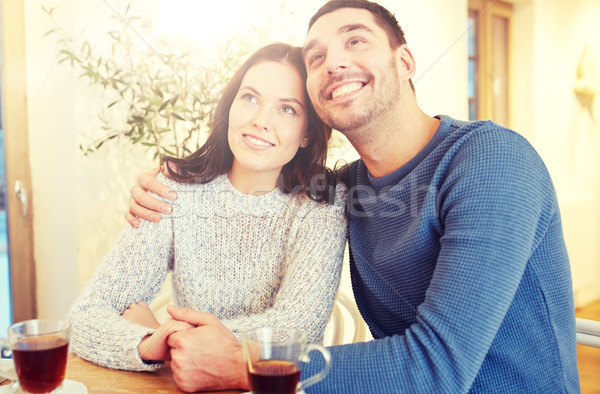happy couple drinking tea at restaurant Stock photo © dolgachov