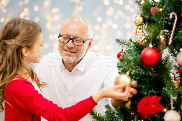 Nagyapa leányunoka karácsonyfa tél ünnepek család Stock fotó © dolgachov