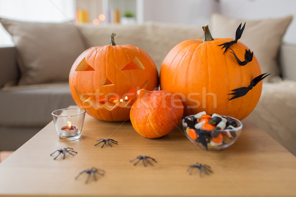jack-o-lantern and halloween decorations at home Stock photo © dolgachov
