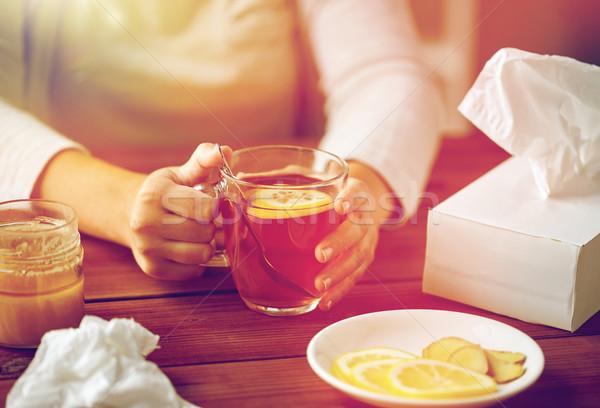 close up of ill woman drinking tea with lemon Stock photo © dolgachov