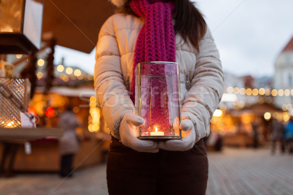 woman with candle in lantern at christmas market Stock photo © dolgachov