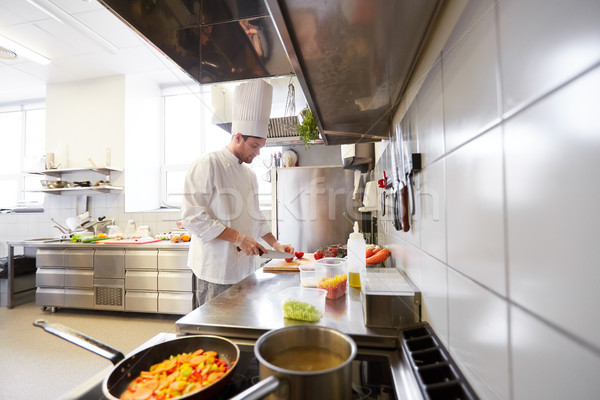 male chef cooking food at restaurant kitchen Stock photo © dolgachov