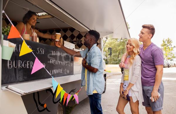 happy customers queue at food truck Stock photo © dolgachov