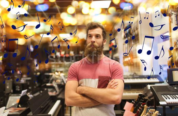 Asszisztens vásárló szakáll zene bolt vásár Stock fotó © dolgachov