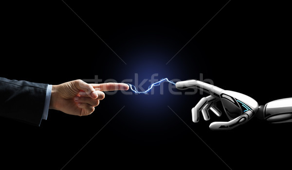 робота человеческая рука Молния бизнеса будущем технологий Сток-фото © dolgachov