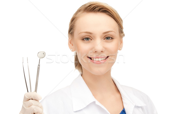 dentist with tools Stock photo © dolgachov
