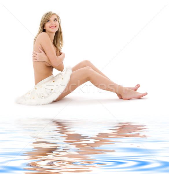 blonde in furry skirt on white sand Stock photo © dolgachov