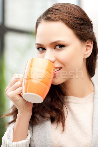 деловая женщина кружка ярко фотография женщину счастливым Сток-фото © dolgachov