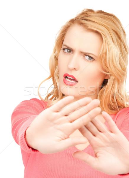 Mujer parada gesto brillante Foto Foto stock © dolgachov