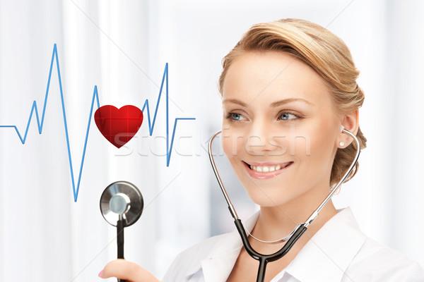 Médico escuta batimento cardíaco quadro atraente estetoscópio Foto stock © dolgachov