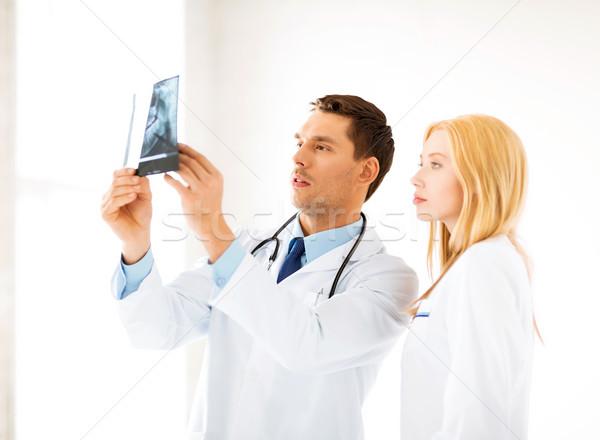 Сток-фото: два · врачи · глядя · Xray · фотография · женщину
