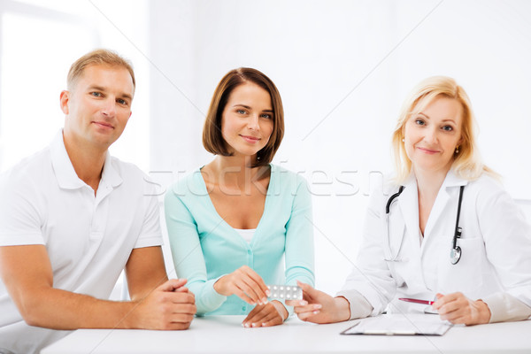 doctor giving pills to patients Stock photo © dolgachov