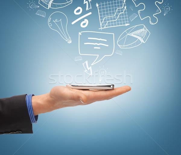 Kéz tart okostelefon ikonok technológia internet Stock fotó © dolgachov