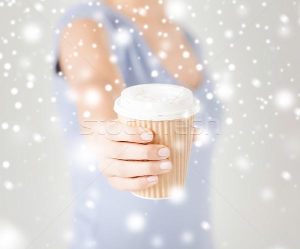 woman hand holding take away coffee cup Stock photo © dolgachov