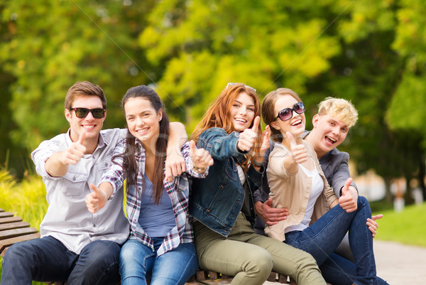 group of students or teenagers showing thumbs up Stock photo © dolgachov
