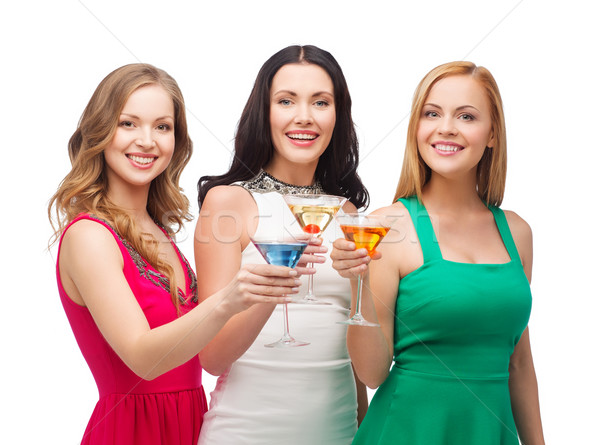 three smiling women with cocktails Stock photo © dolgachov