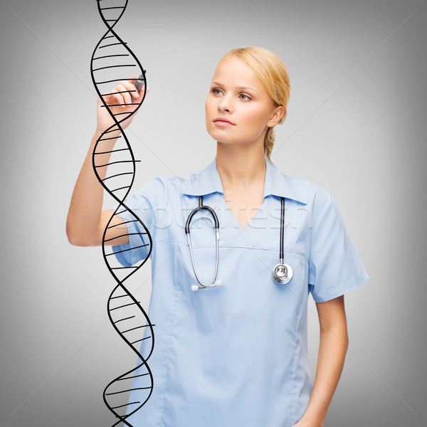 focused doctor or nurse drawing dna molecule Stock photo © dolgachov