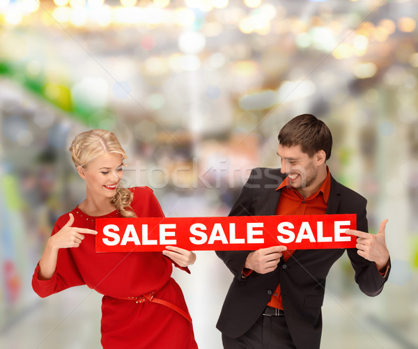 woman and man pointing finger to red sale sign Stock photo © dolgachov