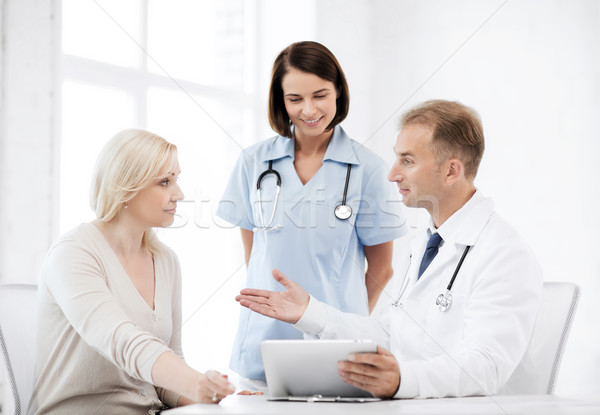 doctor and nurse with patient in hospital Stock photo © dolgachov
