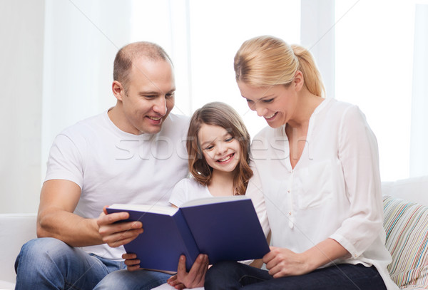 smiling parents and little girl with at home Stock photo © dolgachov