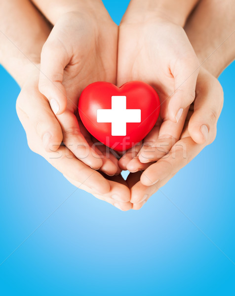 Stock photo: male and female hands with red heart