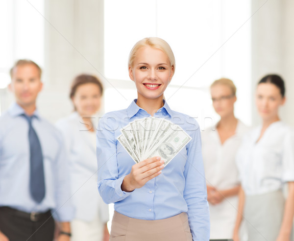 young businesswoman with dollar cash money Stock photo © dolgachov
