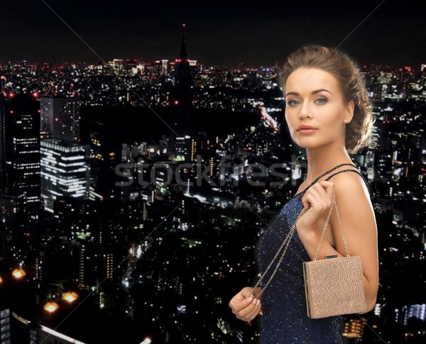 Feliz mulher vestido de noite pequeno saco festa Foto stock © dolgachov