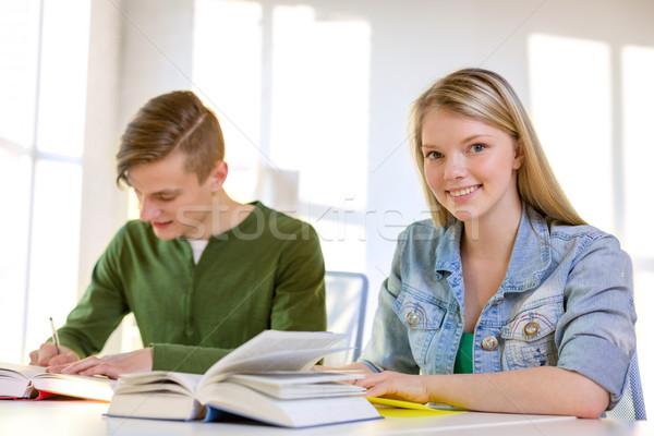 Estudantes livros didáticos livros escolas educação dois Foto stock © dolgachov