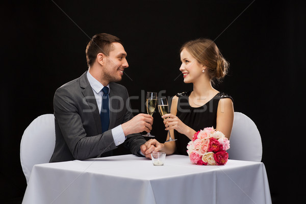Photo stock: Couple · verres · champagne · restaurant · vacances · souriant