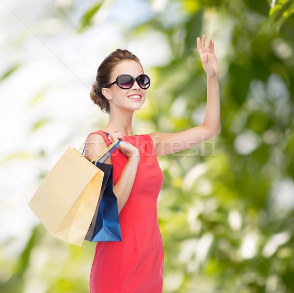 Souriant élégante femme robe Shopping Photo stock © dolgachov