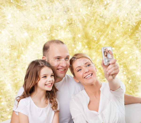 счастливая семья камеры домой семьи праздников технологий Сток-фото © dolgachov