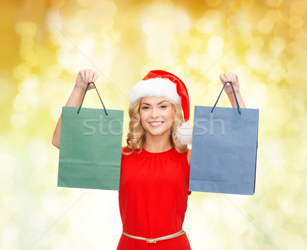 woman in santa helper hat with shopping bags Stock photo © dolgachov