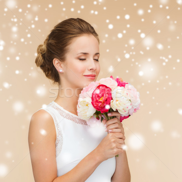 Stock photo: smiling woman in white dress with flowers