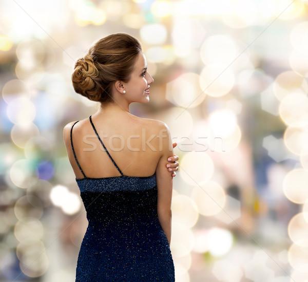 Glimlachende vrouw avondkleding mensen vakantie glamour lichten Stockfoto © dolgachov