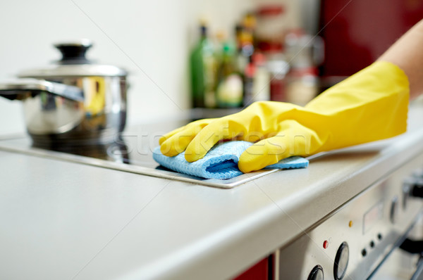 close up of woman cleaning cooker at home kitchen Stock photo © dolgachov