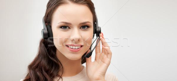 friendly female helpline operator with headphones Stock photo © dolgachov