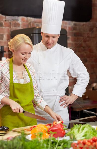 Mutlu erkek şef pişirmek kadın pişirme Stok fotoğraf © dolgachov