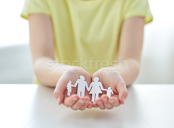 close up of girl hands with paper family cutout Stock photo © dolgachov