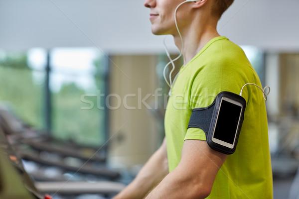 Közelkép férfi testmozgás futópad tornaterem sport Stock fotó © dolgachov