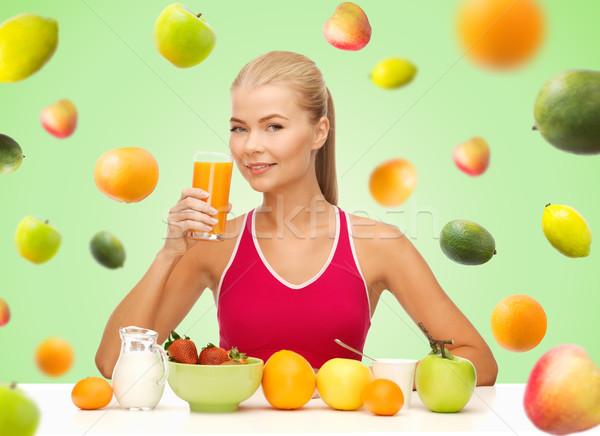 happy woman holding glass of orange juice Stock photo © dolgachov