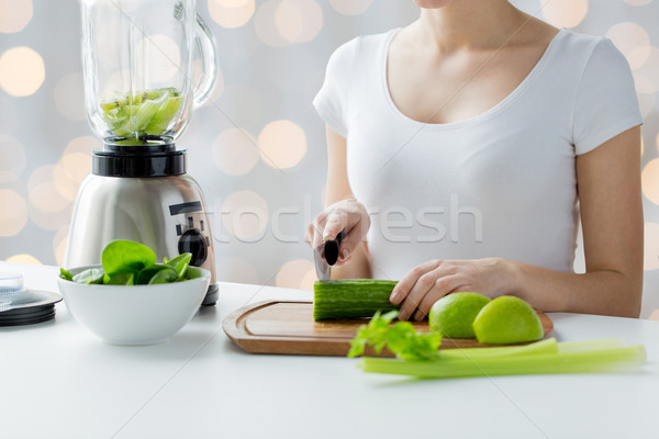 Stock photo: close up of woman with blender chopping vegetables