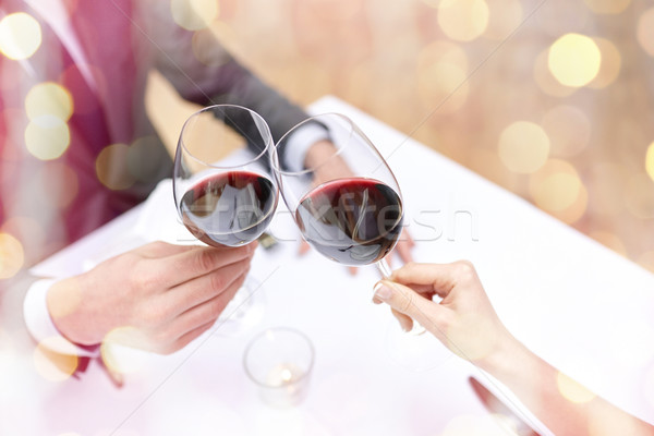 Stock photo: young couple with glasses of wine at restaurant