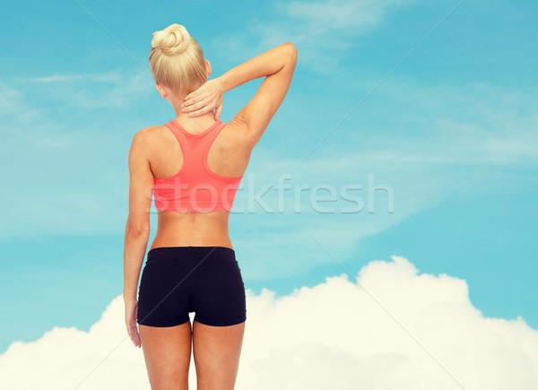 Mulher tocante pescoço fitness saúde Foto stock © dolgachov