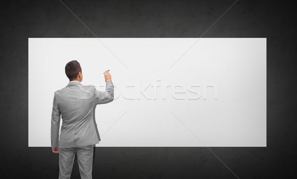 businessman writing or drawing on white board Stock photo © dolgachov