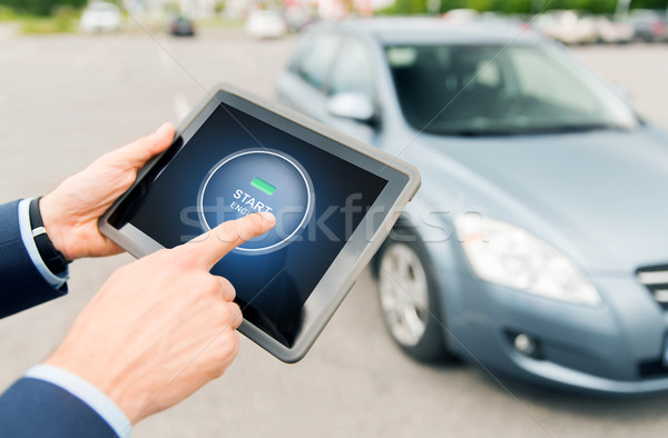 close up of hands with car starter on tablet pc Stock photo © dolgachov