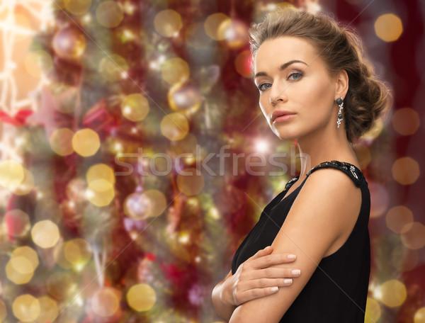 Gyönyörű nő visel fülbevalók fények emberek ünnepek Stock fotó © dolgachov