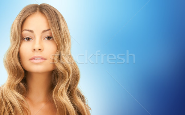 beautiful young woman face with long hair Stock photo © dolgachov