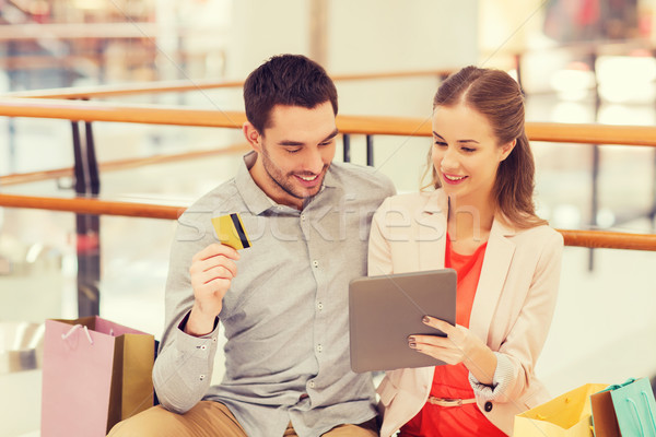couple with tablet pc and credit card in mall Stock photo © dolgachov