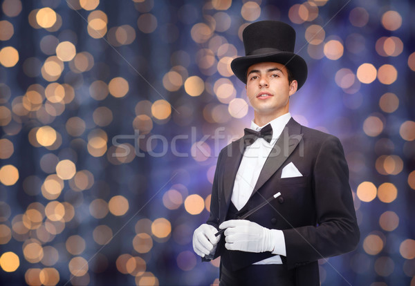 magician in top hat with magic wand Stock photo © dolgachov