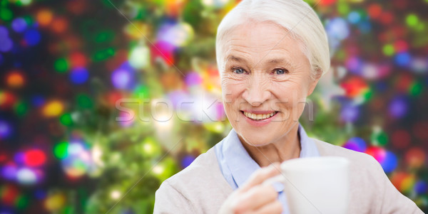 happy senior woman with cup of tea or coffee Stock photo © dolgachov